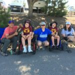 Anita Barraza two of her three kids ride wheelchairs