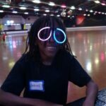 Jahrel wearing some fashionable glasses at a Bounce Bash(tm) skating event.